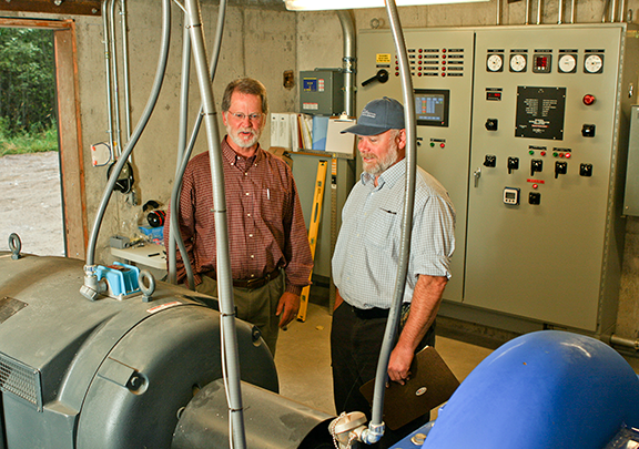 Whitefish Public Works Director John Wilson and Don Newton, Key Accounts Representative for FEC, inspect the generation facility.