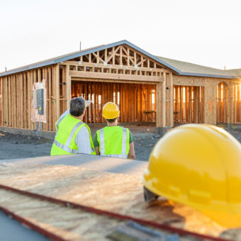 construction workers by house in process of being built